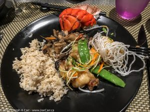 Ginger and garlic wok-seared lobster with sake-braised oyster and shiitake mushrooms, brown rice at the Tamarind restaurant