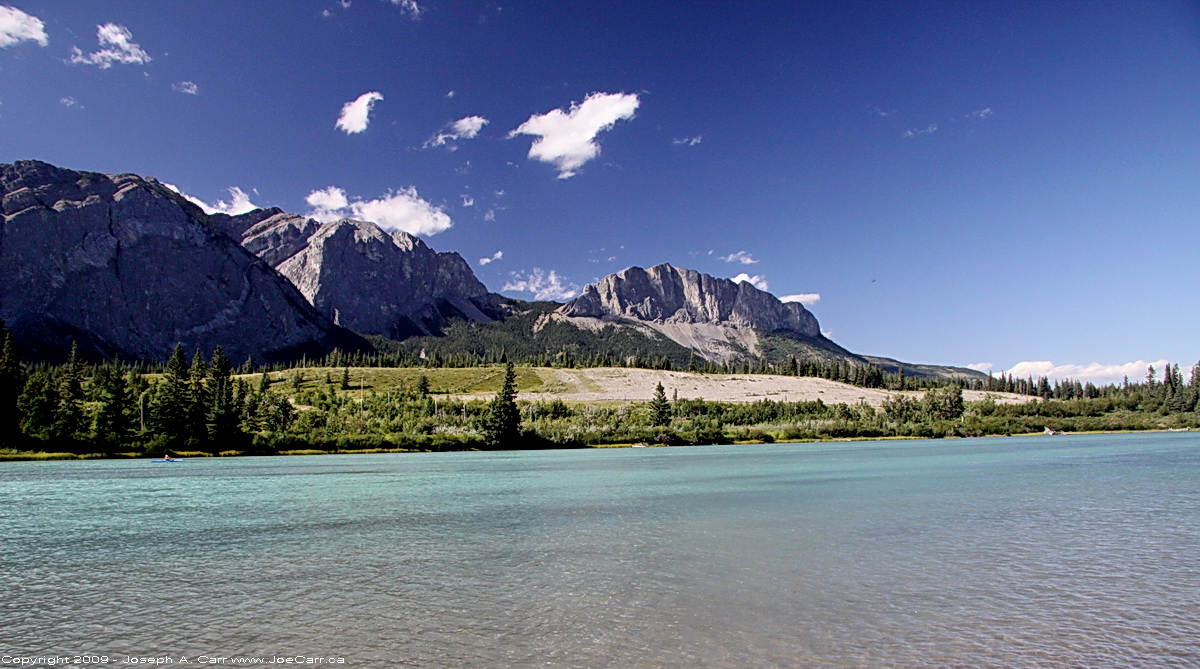 The Rocky Mountains across the Bow River in the Kananaskis, Alberta