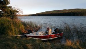 Boat on Lac Le Jeune at sunset