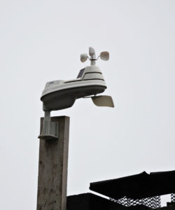Acu-Rite 5-in-1 weather station mounted on the chimney